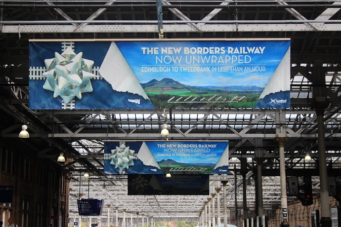 Borders Railway banners hang from Waverley station roof
